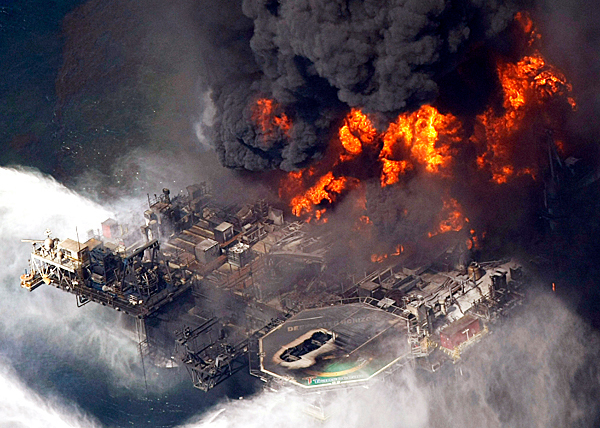 In this aerial photo taken in the Gulf of Mexico more than 50 miles southeast of Venice on Louisiana's tip, the Deepwater Horizon oil rig is seen burning Wednesday, April 21, 2010.  AP PHOTO BY GERALD HERBERT