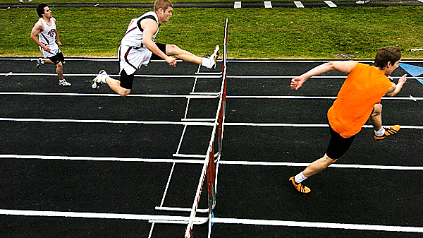 Left to right: Bangor High School's Elijah Growe and Josiah Hartley and trail  Brewer High Schools Tristan Wortman during their  boys' 110 meter hurdles heat of Friday's PVC track meet at Cameron Stadium in Bangor. Brewer High School's Steven Rice won the event.   BANGOR DAILY NEWS PHOTO BY JOHN CLARKE RUSS