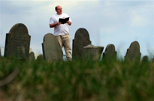 Walter Skold of Freeport, Maine, reads a Henry Wadsworth Longfellow poem while posing in Eastern Cemetery, Tuesday, April 20, 2010, in Portland, Maine. Skold will be leading a poetry reading at the cemetery this Friday to kick off his upcoming 22-state tour to make Oct. 7th &quotDead Poets Remembrance Day.&quot  (AP Photo/Robert F. Bukaty)