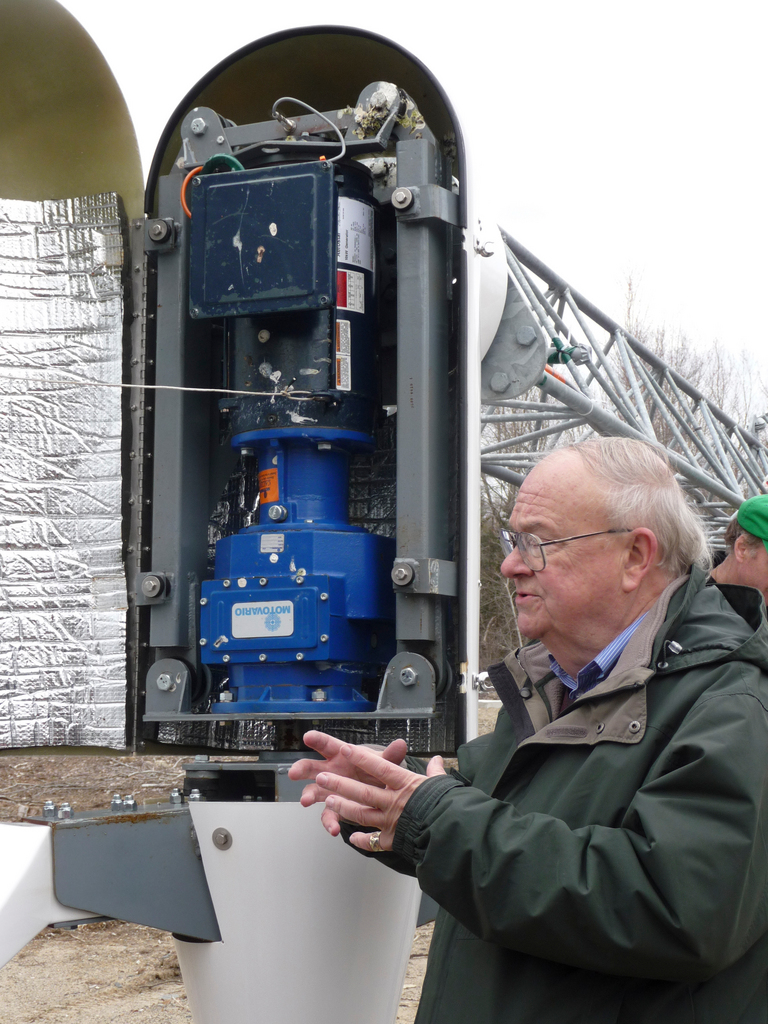 Dr. Walter Johnson, chairman of the Suffolk University of Boston Physics Department, explains the internal workings of the school's wind turbine, located at the Friedman Field Station on the shore of Cobscook Bay in Edmunds. Students and staff lowered the turbine as part of an engineering and physic's course while installing a sound recorder to track the decibels of noise generated by the windmill. BANGOR DAILY NEWS PHOTO BY SHARON KILEY MACK (NOTE: story being sent 4/24)