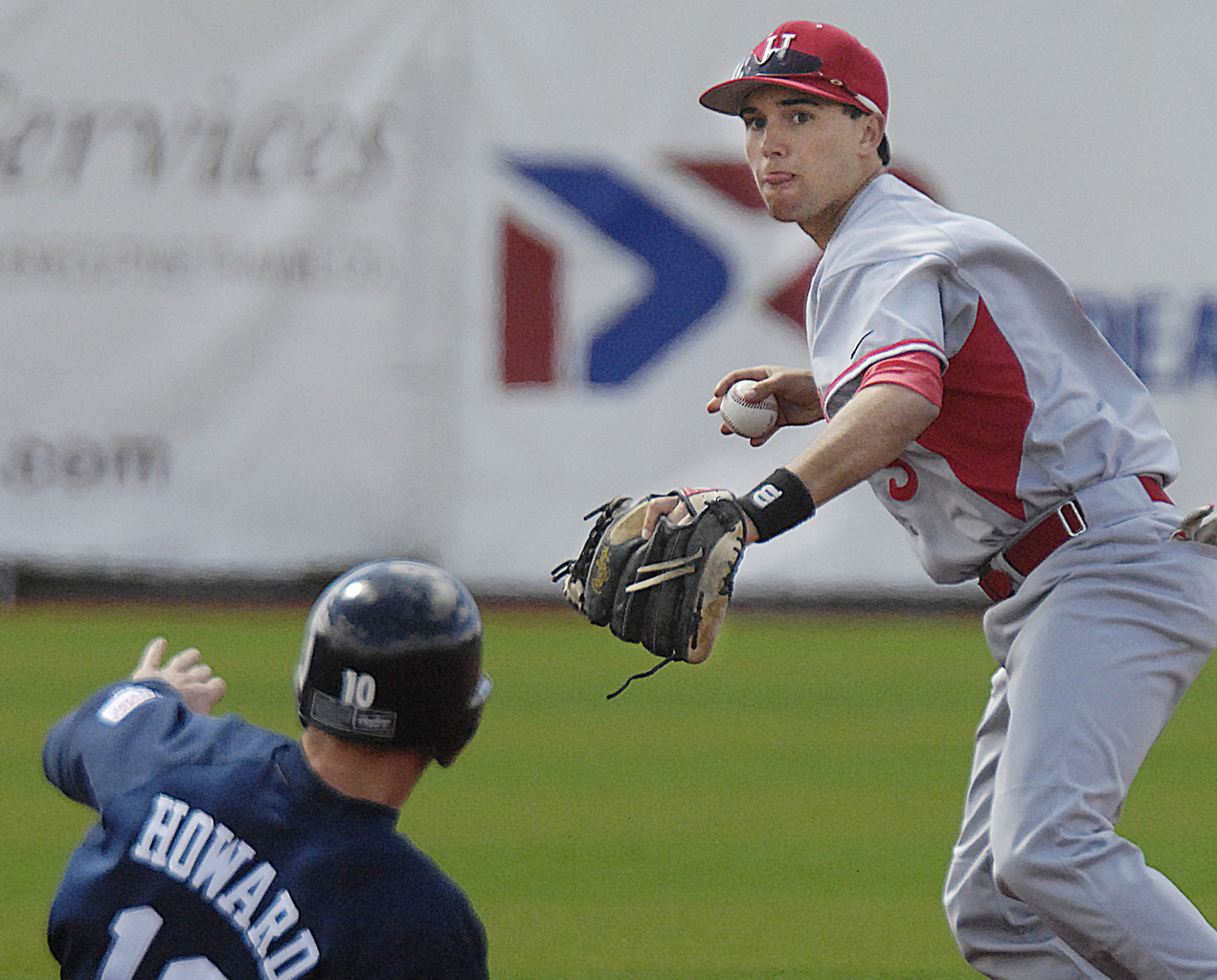 Hartford infielder Corey Beahm, (3), looks to first to make the double play after tagging out Maine's Matt Howard, (10), in the fourth inning of their game in Orono, Sunday, April 25, 2010.  BANGOR DAILY NEWS PHOTO MICHAEL C. YORK