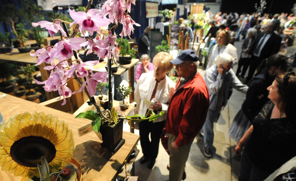 People look at the exhibitors displays at the Bangor Garden Show Saturday morning.  The show returned after a one-year hiatus and is continuing the tradition that started in 1991.  Over 50 landscape and gardening vendors and displays as well as several demonstrations offer a diverse display this spring.   (Bangor Daily News/Gabor Degre)