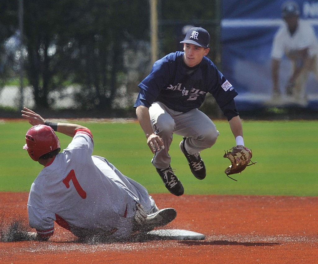 Maine's Mike Fransoso, (2), follows up his throw to first after tagging out Hartford's Bobby Gorski, (7), at second base in the fifth inning of their game in Orono, Sunday, April 25, 2010.  BANGOR DAILY NEWS PHOTO MICHAEL C. YORK