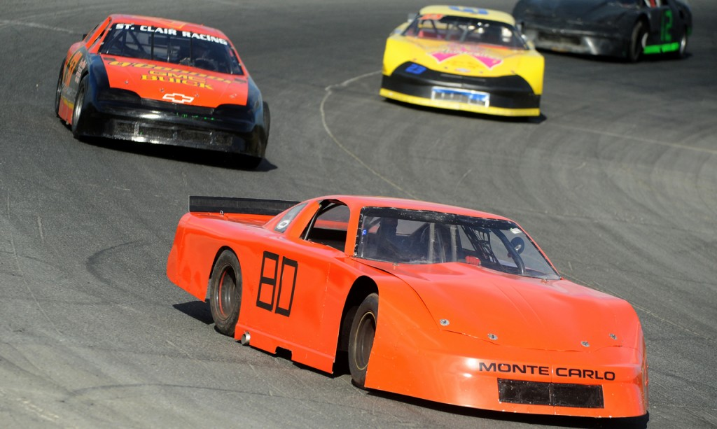Steve Moulton leads the race in his number 80 Monte Carlo during the Super Sreet division 25 lap feature race at Speedway 95 in Hermon Sunday.  Moulton won the 2010 season opening race in his division. (Bangor Daily News/Gabor Degre)