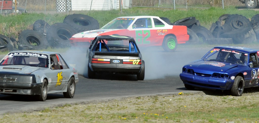 Drivers try to avoid Roy Hawthorn's 07 car as he slides sidewas on the track during the Sp4 division 20 lap feature race at Speedway 95 in Hermon Sunday.  The weather cooperated with drivers and fans this weekend allowing the racway to kick off it's 2010 season. (Bangor Daily News/Gabor Degre)