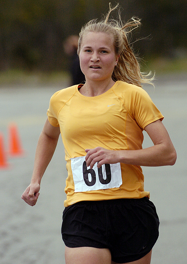 Elizabeth Brunton of Birch Harbor, ME was the top female finisher in the 16th Annual Animal Orphanage 5K Run Walk near the Old Town YMCA Sunday morning. According to organizer Robert Fowler, the event had a record 155 human entrants and approximately 25 canine entrants. &quot Our main goal in this and all off our fundraising events is of course to raise money to help homeless strays that come through our doors,&quot said Fowler. The Animal Orphange is a &quotno-kill&quot animal shelter that accepts strays in Old Town and Orono. BANGOR DAILY NEWS PHOTO BY JOHN CLARKE RUSS