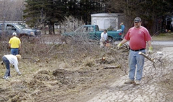 About 20 volunteers were on hand Sunday to help begin clearing brush and trash from 35-acres that will house the future Ark Animal Sanctuary in Houlton. Among them was Steve Elland who put in a day hauling branches and brush. Photo courtesy of Ark Animal Sanctuary.