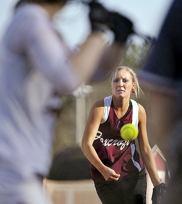 Foxcroft Academy's pitcher ,(Kelsey Boss),  delivers a pitch  in the 5th inning of their game versus Orono , in Orono, Monday, April  26, 2010. BANGOR DAILY NEWS PHOTO BY MICHAEL C. YORK