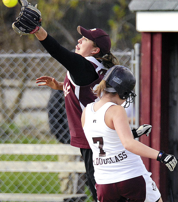 Foxcroft's third baseman Vanessa Lougee takes a high throw too late to tag Orono's Kristen Douglas, (7), in the third inning of their game in Orono, Monday, April 26, 2010. BANGOR DAILY NEWS PHOTO BY MICHAEL C. YORK