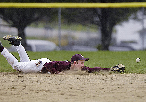 Ellsworth's shortstop B. Folmer, (7), makes a diving attaempt at a sharply hit ball in the second inning of their game versus Hermon, in Hermon, Tuesday, April 27, 2010. BANGOR DAILY NEWS PHOTO BY MICHAEL C. YORK