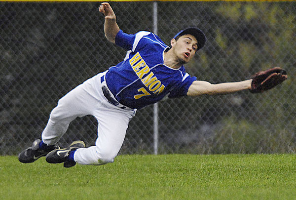 Hermon center fielder J. Graffam, (7),  makes a diving catch on a sinking ball in the fourth inning of their game versus Ellsworth, in Hermon, Tuesday, April 27, 2010.