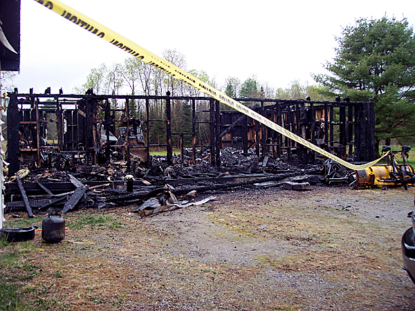 Investigators are still trying to determine the case of the fire that destroyed this home at 293 Winnecook Road in Burnham early Wednesday morning. BANGOR DAILY NEWS PHOTO BY CHRISTOPHER COUSINS