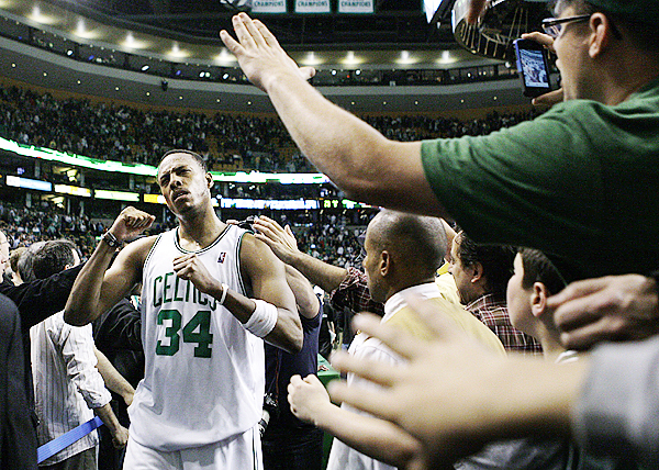Boston Celtics forward Paul Pierce pumps his fist as he is congratulated by fans after the Celtics beat the Miami Heat 96-86 in Game 5 of a first-round NBA basketball playoff series, in Boston on Tuesday, April 27, 2010. The Celtics eliminated the Heat from the playoffs. (AP Photo/Charles Krupa)