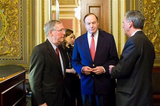 Senate Minority Leader Mitch McConnell, R-Ky., Sen. Richard Shelby, R-Ala., and Sen. Judd Gregg, R-N.H., confer after leaving a Republican Caucus on Capitol Hill in Washington, Wednesday, April 28, 2010.(AP Photo/Harry Hamburg)