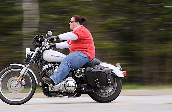 Taking advantage of Tuesday afternoon's sun, Jeri Leonard of Hampden cruises own Dirigo Drive in Brewer on her 2004 Harley-Davidson 1200 Sportster. BANGOR DAILY NEWS PHOTO BY JOHN CLARKE RUSS