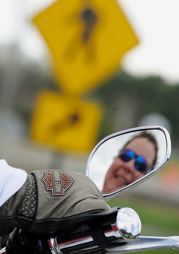 Jeri Leonard of Hampden dons her Harley-Davidson gloves while gripping the the throttle on her 2004 Harley-Davidson 1200 Sportster as she gets ready to cruise central Maine Tuesday afternoon, April 20, 2010. BANGOR DAILY NEWS PHOTO BY JOHN CLARKE RUSS