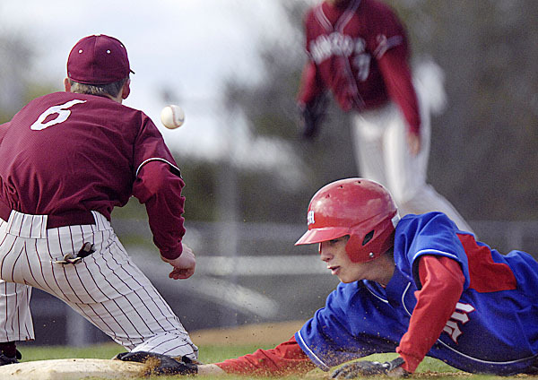 Messalonskee's P. Wrigley , (11), slides back to first ahead of the ball to Bangor firstbaseman Jacques LaRochelle, (6), in the second inning of their game in Bangor Thursday, April 29, 2010. BANGOR DAILY NEWS PHOTO BY MICHAEL C. YORK
