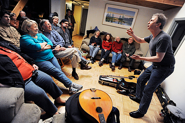 Jim Payne of Notre Dame Bay, Newfoundland--a songwrtier and performer of traditional music-- captivates the crowd at 430 Bayside as he tells the yarn &quotJack and the Magic Punt&quot during his appearance with Irish-Canadian folk musician Fergus O'Byrne Monday evening , April 20, 2010. 430 Bayside in Ellsworth is the residence of Steve Peer who has been hosting a regular series of concerts with Canadian and American musicians in his home. BANGOR DAILY NEWS PHOTO BY JOHN CLARKE RUSS