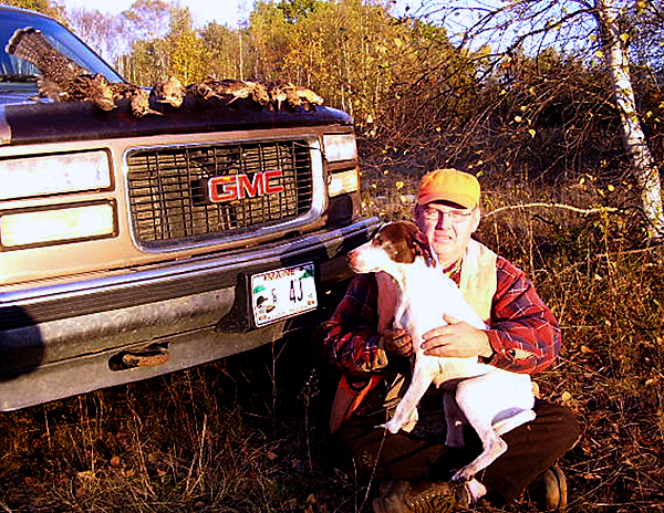 Jay Robinson of Woodville poses with his English pointer, Katie, after a bird hunting trip. Katie ran off and disappeared from Robinson's home in February, but was returned to him in April.  PHOTO COURTESY OF JAY ROBINSON