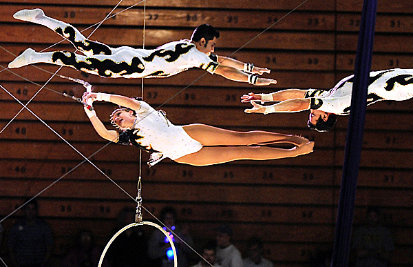 Robinson Cortes (cq) (right)  gets ready to catch his brother Alex Cortes (top left) after releasing fellow trapeze artist Gemma Kirby during their &quotpassing leap&quot maneuver of the Flying Cortes Family's trapeze performance of Friday afternoon's Anah Shrine Circus show at Bangor Auditorium. The 47th Annual Anah Shrine Circus runs April 30, May 1 and May 2 in Bangor.   BANGOR DAILY NEWS PHOTO BY JOHN CLARKE RUSS