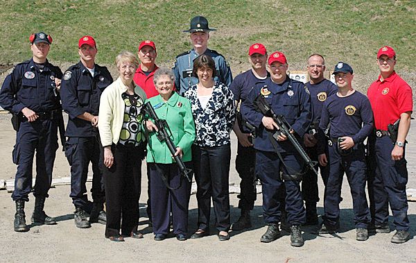 Representative Beaudoin, along with State Representative Anne Haskell from Portland, Commissioner Anne Jordan and Colonel Fleming recently observed the training for the new gun at a range in Scarborough. Rep. Beaudoin is holding the AR-15 between Rep. Haskell and the commissioner.  State Police members in the photo from left to right are Troopers John Davis & Lance McLeish, Sgt. William Keith, Col. Fleming, Troopers Andre Paradis & Jeff Degroot, Corporal Ed Furtado, and Troopers Eric Paquette and Jonathan Leach.  PHOTO COURTESY OF MAINE DEPT OF PUBLIC SAFETY