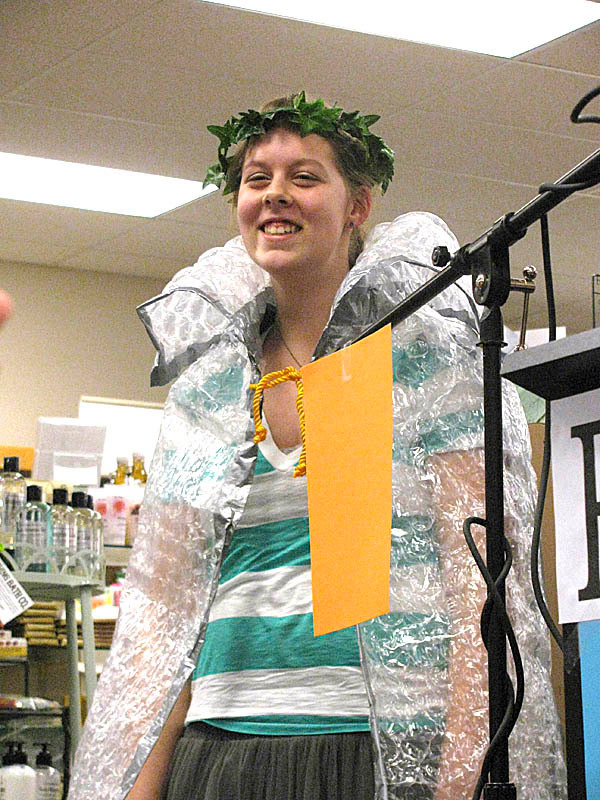 The newly-named 2010 Waldo County Young Poet Laureate Genevieve Shepard received her crown and bubble-wrap cape Thursday night at Mr. Paperback bookstore. &quotI'm so happy,&quot she said about the honor. BANGOR DAILY NEWS PHOTO BY ABIGAIL CURTIS