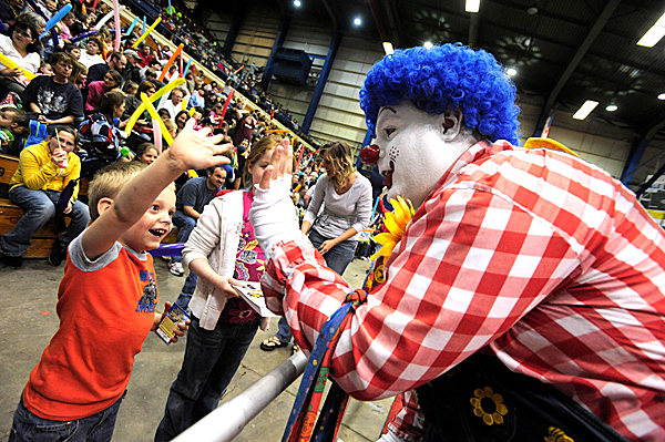&quotScooter&quot, an Anah Shrine clown,  high fives his new friend, five-year-old Ethan Mushero of Alton, ME before the start of Friday afternoon's Anah Shrine Circus at Bangor Auditorium. The 47th Annual Anah Shrine Circus runs April 30, May 1 and May 2 in Bangor.  BANGOR DAILY NEWS PHOTO BY JOHN CLARKE RUSS