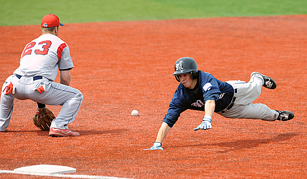 The University of Maine's Michael Fransoso (right) dives to third base beating the throw to Stony Brook's Stephen Marino during the 3rd inning of the game in Orono Sunday.   BANGOR DAILY NEWS PHOTO BY GABOR DEGRE