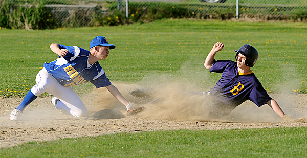 Bucksport High School's Ryan Bailey slides to second base beating the tag by Hermon High School's 5 during the game in Bucksport Saturday afternoon.  Bucksport won the game 4-3.  BANGOR DAILY NEWS PHOTO BY GABOR DEGRE