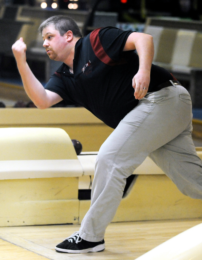 Brian Purdy of Buckston bowls during the State Candlepin championship at Bangor-Brewer Lanes in Brewer Sunday.  BANGOR DAILY NEWS PHOTO BY GABOR DEGRE