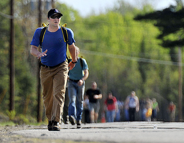 Forest Service 'Hot Shot' hopefuls donned 45 pound packs and took to a 3 mile timed course during qualification testing at the  Forest Service office in Old Town, Maine, Sunday, May 2, 2010. BANGOR DAILY NEWS PHOTO BY MICHAEL C. YORK