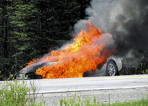 Passing motorist  Randy Spencer said that this car appeared empty and was just starting to burn before it became a fireball  along Route 15 in Abbot when he stopped Monday, May 3, 2010. He said he called 911, and was told by a dispatcher that a  fire truck was already enroute and that the vehicle was empty of people. (Photo courtesy of Randy Spencer)