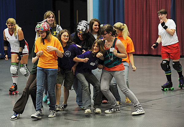 Gunner Hands Off, left , and Lady Gay Gay, right, watch as members of high school civil rights teams from around the state participate in a roller derby jam while taking part in a workshop put on by Maine Roller Derby at the state wide conference of high school civil rights teams held on Monday, May 3, 2010 at the Augusta Civic Center. BANGOR DAILY NEWS PHOTO BY KEVIN BENNETT