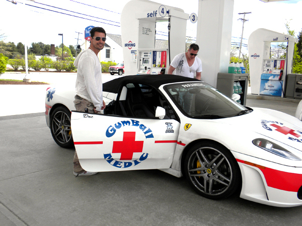 San Diego residents Dr. Michael Moreno, nicknamed &quotDoc,&quot left, and lawyer Michael Kelly get into Kelly's Ferraris F-430 that stopped at the Odlin Road Irving store to get gas before taking off to Boston as part of the international Gumball 3000. The 120-car rally race, which costs $50,000 to enter, started May 1 in London and will end May 7 in New York City. Moreno and Kelly flew into Bangor International Airport aboard Kelly's personal plane and landed hours before the rest of the rally racers. A number of celebrities, including Skateboard great Tony Hawk, are amongst the participants.  Moreno said he rarely drives Kelly's super fast sports car.  &quotI only do it if I have to,&quot he said. &quotI'm here to relax.&quot The Gumball is more of a road trip, he said, instead of a race.      BANGOR DAILY NEWS PHOTO BY NOK-NOI RICKER