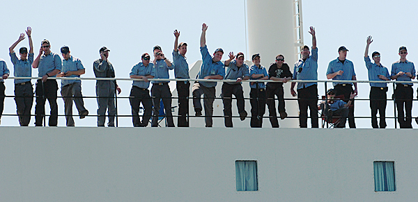 Midshipmen aboard the Maine Maritime Academy's training ship State of Maine wave to family and friends on land as the ship is pushed away from the dock in Castine in 2010.