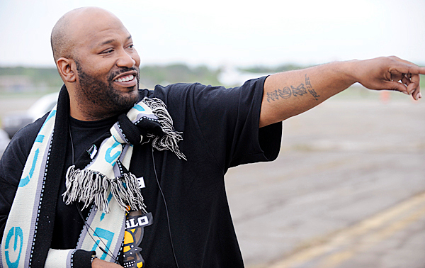 American rapper Bun B , a competitor in the Gumball 3000 Rally, spots a freind in the crowd as he waits to leave BIA's tarmac in his high-performance rally car Tuesday afternoon. BANGOR DAILY NEWS PHOTO BY JOHN CLARKE RUSS