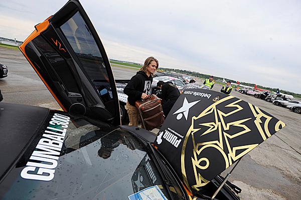Rally driver Jon Olson of Sweden moves his luggage into the trunk of his team's Lamborghini shortly after arriving in Bangor International Airport Tuesday afternoon to continue the next leg of the Gumball 3000 Rally. BANGOR DAILY NEWS PHOTO BY JOHN CLARKE RUSS