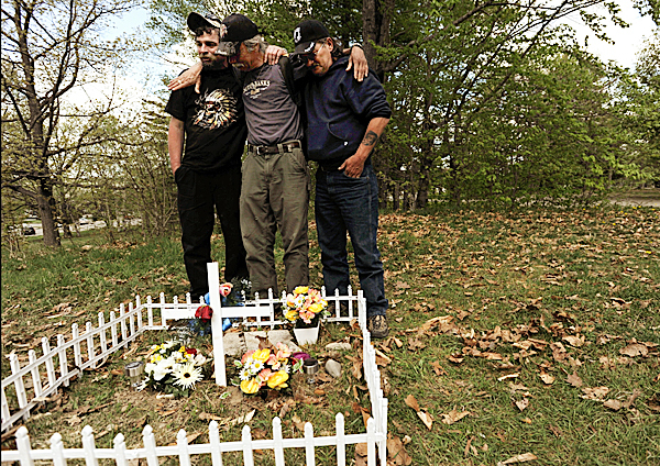 Jody Webber, left, who said he was Jayne Blackington's boyfriend for the last few months, is comforted by Matt Prewitt, center, and Hugh &quotFrenchy&quot French, also friends of  Blackington, Wednesday, May 5, 2010, at a memorial built by the three homeless men on the spot where Blackington's body was found last week in Bangor. The three men hope to hold a memorial service at the location soon. The area is within sight of the Acadia Recovery Community building at 179 Indiana Ave. BANGOR DAILY NEWS PHOTO BY KEVIN BENNETT