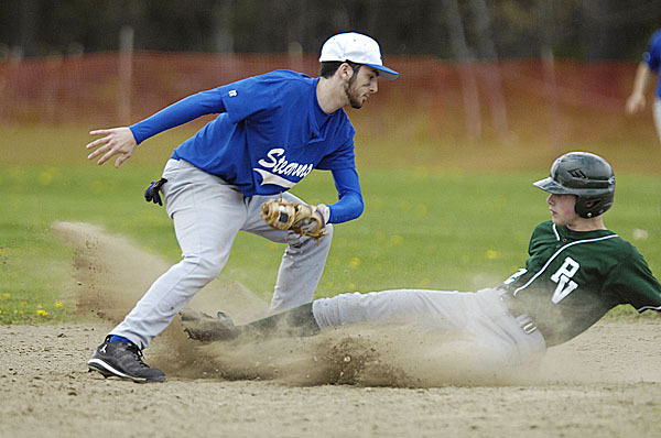 Stearn's Garen Manzo, (2), tags out Howler's Robbie Hallett, (22), at second base in the 4th inning of their game in Howland, Wednesday, May 5, 2010. BANGOR DAILY NEWS PHOTO BY MICHAEL C. YORK