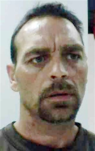 This 2010 booking photograph released by the Maine State Police shows Raymond Bellavance, of Augusta, Maine. An arrest warrant has been issued for  Bellavance in connection with the June 2009 fire at the Grand View Topless Coffee Shop.  (AP Photo/Maine State Police)