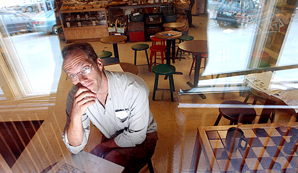 Science fiction-fantasy writer Alex Irvine, who teaches creative writing at the University of Maine, does some of his writing at The Store in Orono.  BANGOR DAILY NEWS FILE PHOTO BY GABOR DEGRE