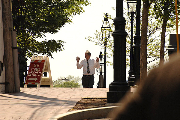 A personr get off the Greyhound bus with his arms up in Portsmouth, New Hampshire at the scene of a bomb threat Thursday, May 6, 2010. (Photo by Lorenzo Vigil)