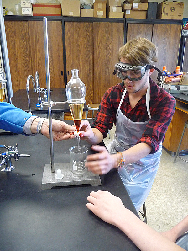 Zach Roos, 17, of Jonesboro, assisted by lab partner Fred Barstow, 17, of Perry, prepares to separate biodiesel fuel from glycerin in a separatory funnel at Washington Academy in East Machias. Teacher Dan Spranger uses his Coastal Ecology classes for juniors and seniors to hands-on applications of alternative energy, recycling and reuse. The fuel will be used to heat the school's greenhouse project and the glycerin that is extracted is converted into hand soap.  BANGOR DAILY NEWS PHOTO BY SHARON KILEY MACK