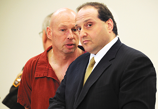 Horst Wolk, left, whispers into the ear of his attorney, Joe Baldacci, during his initial appearance on Friday, May 7, 2010 at the Penobscot Judicial Center in Bangor. Wolk is charged with attempted murder in connection with the Wednesday stabbing of his wife at Husson University. BANGOR DAILY NEWS PHOTO BY KEVIN BENNETT
