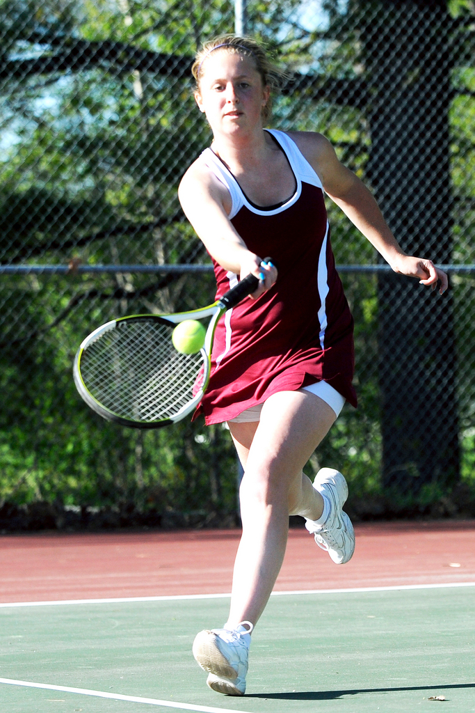 Bangor High School's Kristen Ellis makes a return during her 1st singles match against Brewer High School's Annie McKay in Bangor Friday afternoon.  BANGOR DAILY NEWS PHOTO BY GABOR DEGRE