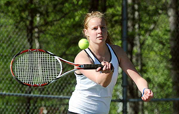 Brewer High School's Annie McKay makes a return during her 1st singles match against Bangor High School's Kristen Ellis in Bangor Friday afternoon.  (Bangor Daily News/Gabor Degre)