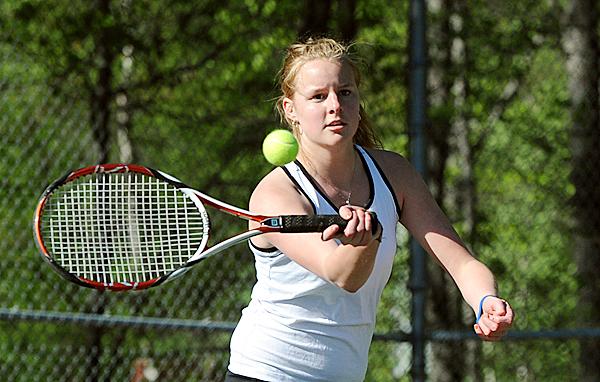 Brewer High School's Annie McKay makes a return during her 1st singles match against Bangor High School's Kristen Ellis in Bangor Friday afternoon.  (Bangor Daily News/Gabor Degre)