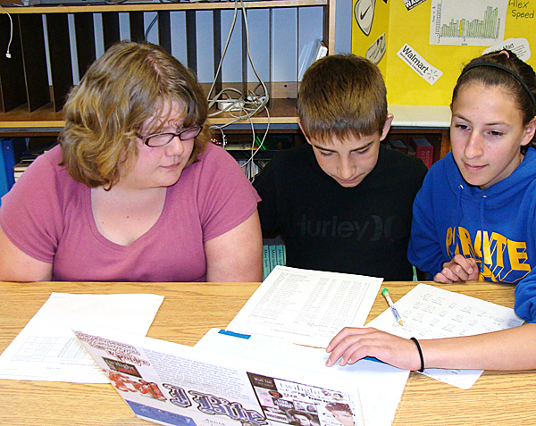 While the Stock Market Game closed last Friday, Piscataquis Community Middle School pupils from left: Carolyn Mumley, Alex Speed, and Tristen French continued to monitor the stocks they selected this week.  BANGOR DAILY NEWS PHOTO BY DIANA BOWLEY