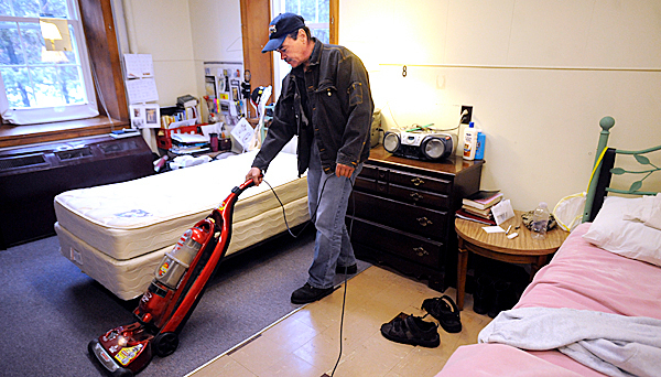 Jim Paradis Sr. does cleaning chores in a room he shares with four other men at the Elijah House program of Manna Ministries.  Paradis became a resident in january of 2010.  &quotI lived on the banks of the Kenduskeag Stream under tarps or whatever kept me dry.  Originaly I came here for shelter but it is a joy not to be inside the beer bottle.&quot  he said.  Paradis credits the staff of Manna Ministries with his recovery.  &quotThey give us our dignity back and teach us to be responsible.&quot  BANGOR DAILY NEWS PHOTO BY GABOR DEGRE