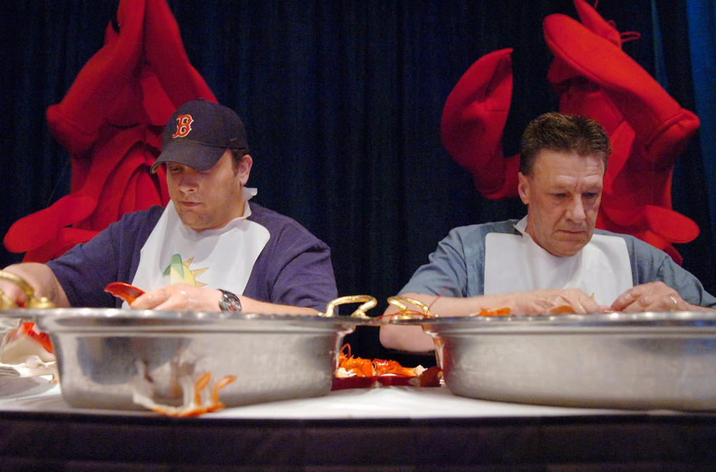Steve Tibbetts of Jefferson (left) and Al Morrill of Bangor participate in the final round of a Lobster Pickin' contest at Hollywood Slots in Bangor on Thursday, May 6, 2010. Tibbetts won the event which pitted nine contestants against each other for a free all-you-can-eat lobster buffet and $500 in free slot play. (Bangor Daily News/Bridget Brown)